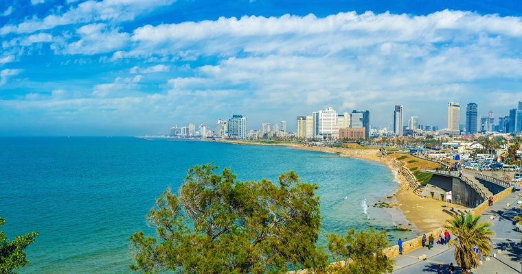 TEL AVIV, ISRAEL - FEBBRUARY 25, 2016: Panorama of the coast with the comfortable sand beaches, modern luxury hotels and scenic promenade, on February 25 in  Tel Aviv.