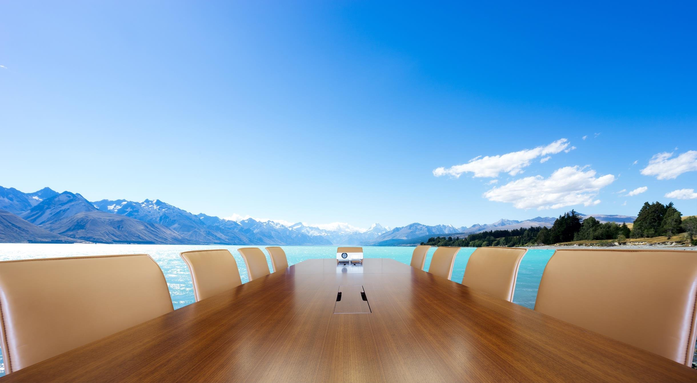 painted conference table with blue lake in blue sky